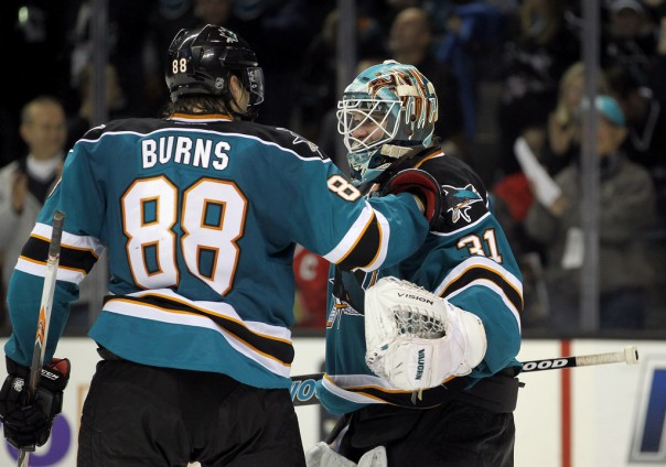 Niemi congratulated by Derko's D-Man... er, I mean forward...er, I mean D-man...er.... what is he?