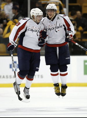 Washington Capitals' Alex Ovechkin, right, and teammate Nicklas Backstrom leap in the air to body bump after the Capitals defeated the Boston Bruins recently. Backstrom separated his shoulder, broke his ankle, and suffered a grade 1 concussion in the celebration.
