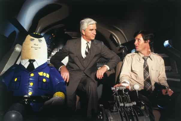 Leslie NIELSEN with linemates Robert Hays & Otto Pilot