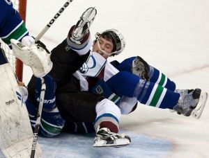Duchene crashes the Vancouver net and gets spooned by a discrete Canuck D-Man