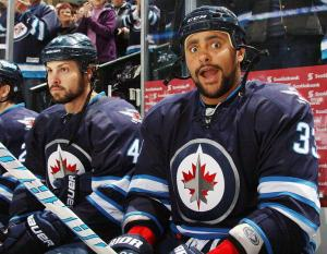 Byfuglien seems surprised to be photographed with Bogosian and the other D-men of the Jets since he hasn't played that end of the ice since Noel left.