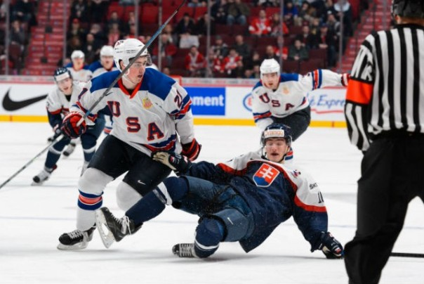 Team USA forward Dylan Larkin goes around EZ, who broke his ankle on this play. YEEEEEOUUCCHHHH!