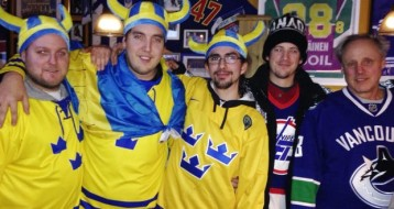 The Swedish fans get it right. The other two? Obviously went to the game friendless. I mean, what friend would allow you to go out like that????