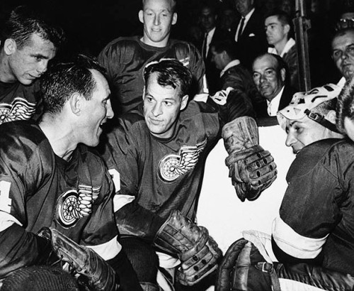 """FILE - In this Oct. 27, 1963, file photo, Detroit Red Wings star forward Gordie Howe is surrounded by teammates as he kneels after scoring his 544th goal to tie the National Hockey League all-time record, in Detroit. From left are Larry Jeffrey, Bill Gadsby, Howe, and Terry Sawchuck. Behind Howe is Alex Faulkner. Gordie Howe, the hockey great who set scoring records that stood for decades, has died. He was 88. Son Murray Howe confirmed the death Friday, June 10, 2016, texting to The Associated Press: """"Mr Hockey left peacefully, beautifully, and w no regrets."""""""