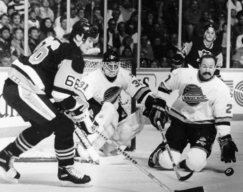 "Back in the day... Lemieux & Rob Brown are thwarted by ""Harrrrrrrr-rold!"" Love Mario's Microns."