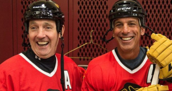 "One of these guys looks like he's still playing. The other looks like he's enjoyed ""Unlimited Poutine."""